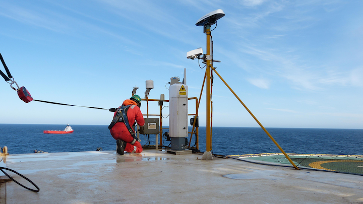 A Fugro engineer installs an enhanced monitoring system to the Ocean Guardian's existing helideck system.