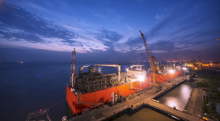 Barge-based floating storage and regasification unit