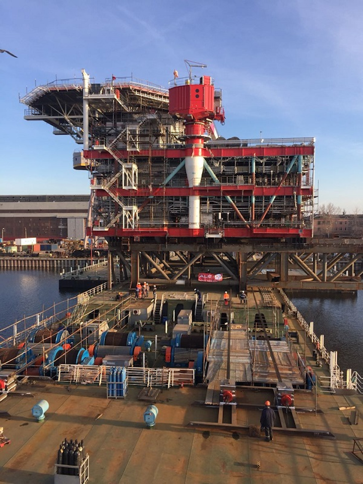 load-out of the 3,200-ton satellite platform topsides for Lukoil's Korchagin oil field development
