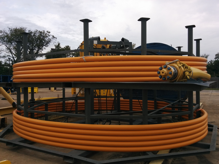 Thermoplastic composite pipeline is a non-conductive, non-corrosive flexible pipe designed for installation through a subsea pallet or from a reel on a vessel.