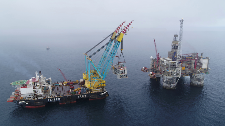 The Saipem 7000 lifting the 3,500-metric ton Dvalin gas processing/compression module onto the Equinor-operated Heidrun platform in the Norwegian Sea.