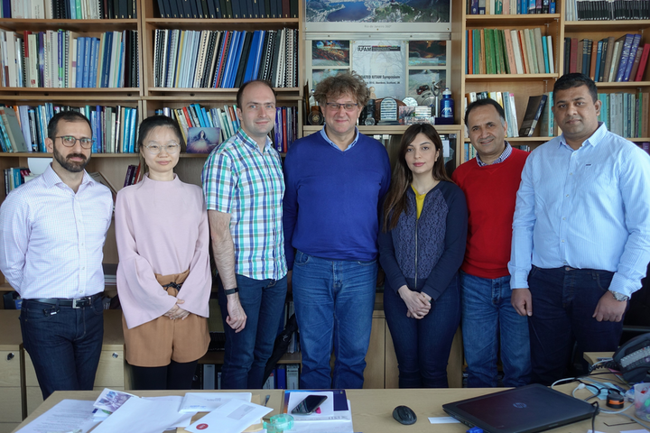 Professor Marian Wiercigroch, Director of CADR, is pictured (center) with members of the CADR team.